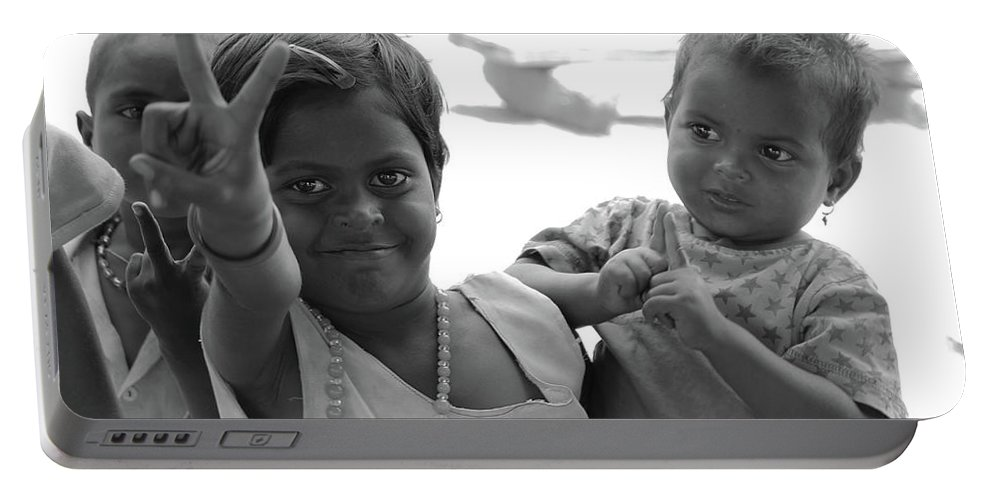 Smile...cost Free.. Portable Battery Charger featuring the photograph Smiles.. by Supriya Basa
