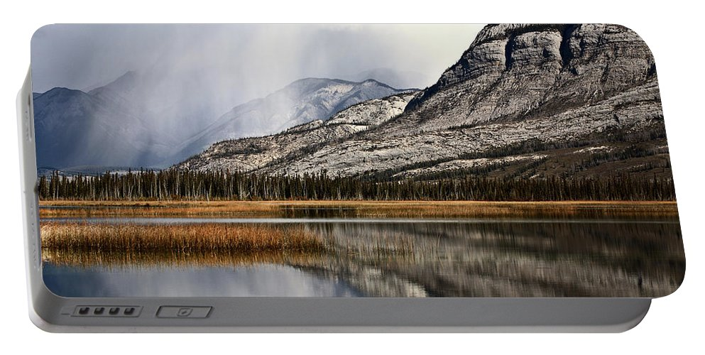 Rocky Mountains Portable Battery Charger featuring the digital art Snow Clouds In The Rocky Mountains Of Alberta by Mark Duffy