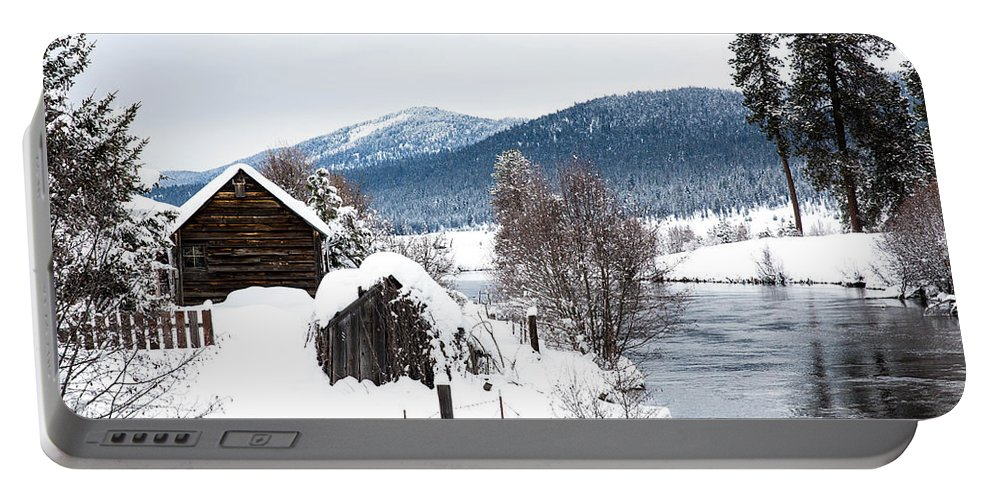 Cabin Portable Battery Charger featuring the photograph Snow Covered Cabin by Michael Parks
