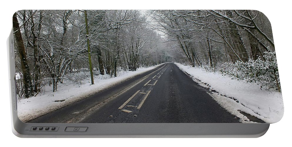 Snow Portable Battery Charger featuring the photograph Snow Covered Road by Dave Philp