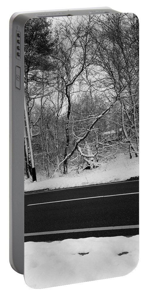 Snow Portable Battery Charger featuring the photograph Snow On Fallen Tree by Rob Hans