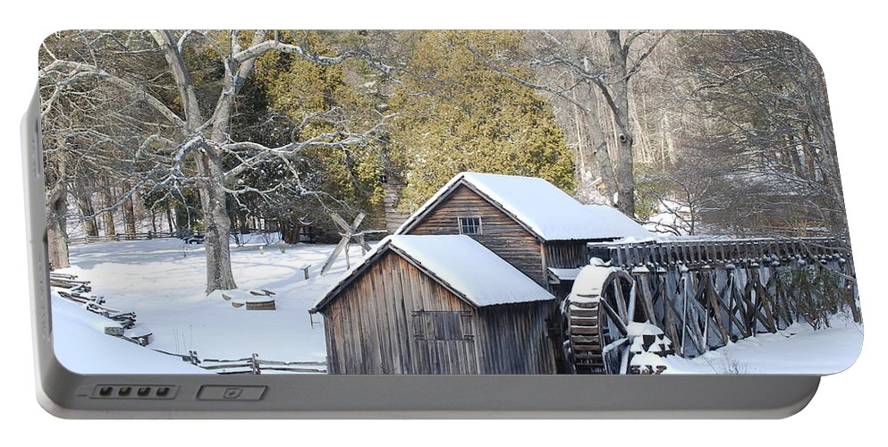 Wildlife Portable Battery Charger featuring the photograph Snow On The Mill by Eric Liller