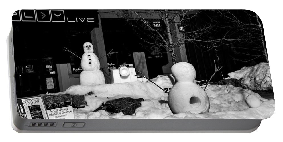 Mccall Portable Battery Charger featuring the photograph Snowball Fight by Angus Hooper Iii
