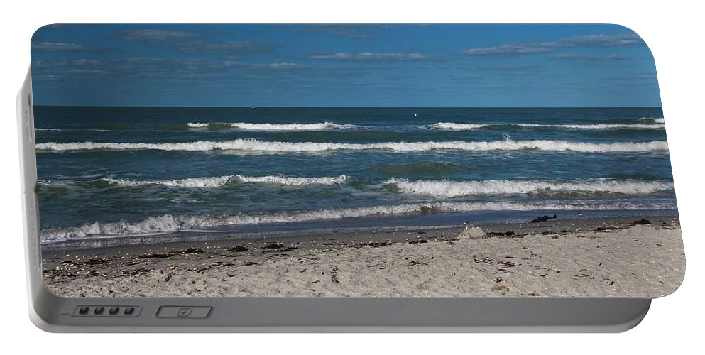 Waves Portable Battery Charger featuring the photograph Songstress by Michiale Schneider