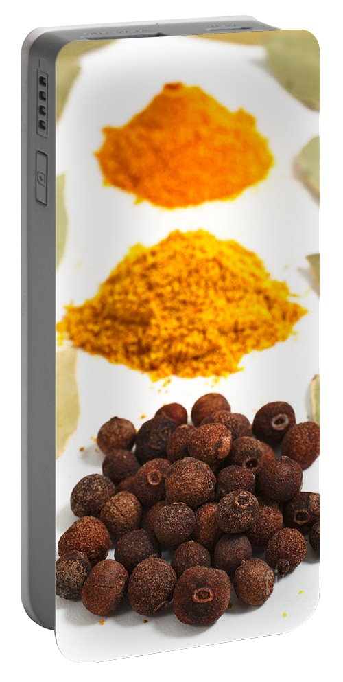 Curry Portable Battery Charger featuring the photograph Spices by Gaspar Avila