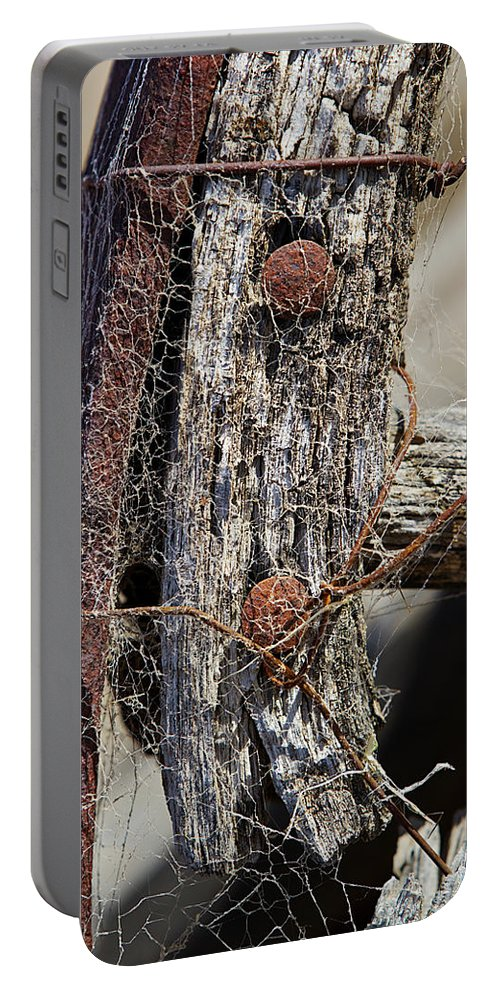 Wheel Portable Battery Charger featuring the photograph Spider Web by Phyllis Denton