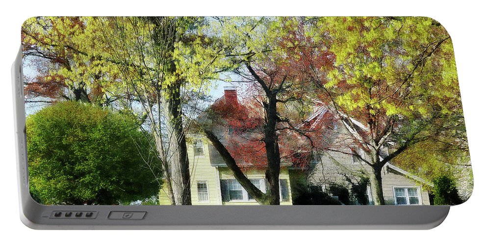 Spring Portable Battery Charger featuring the photograph Spring Begins In The Suburbs by Susan Savad