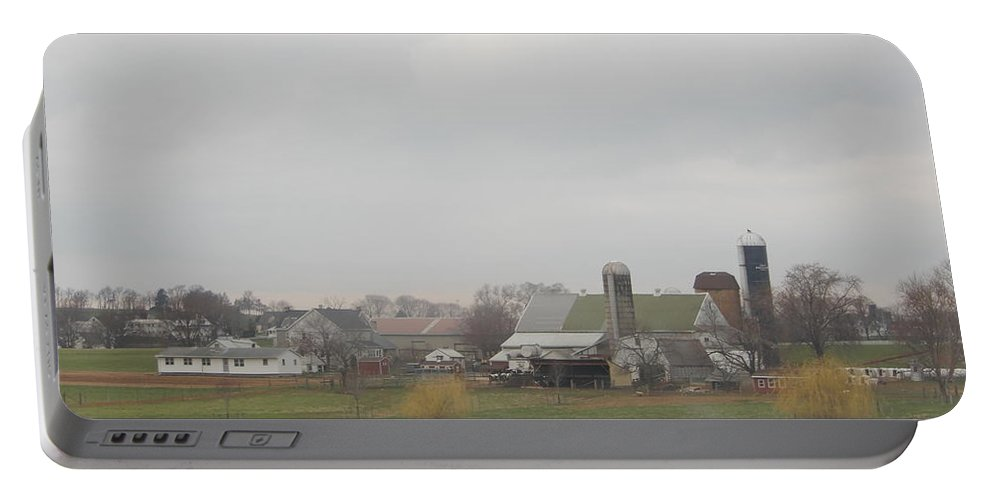 Amish Portable Battery Charger featuring the photograph Spring Skies Over An Amish Farm by Christine Clark