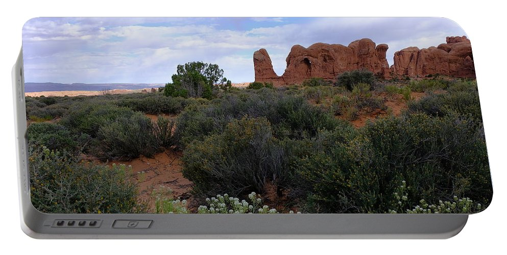 Rock Formation Portable Battery Charger featuring the photograph Springtime At Arches by Jessica Myscofski
