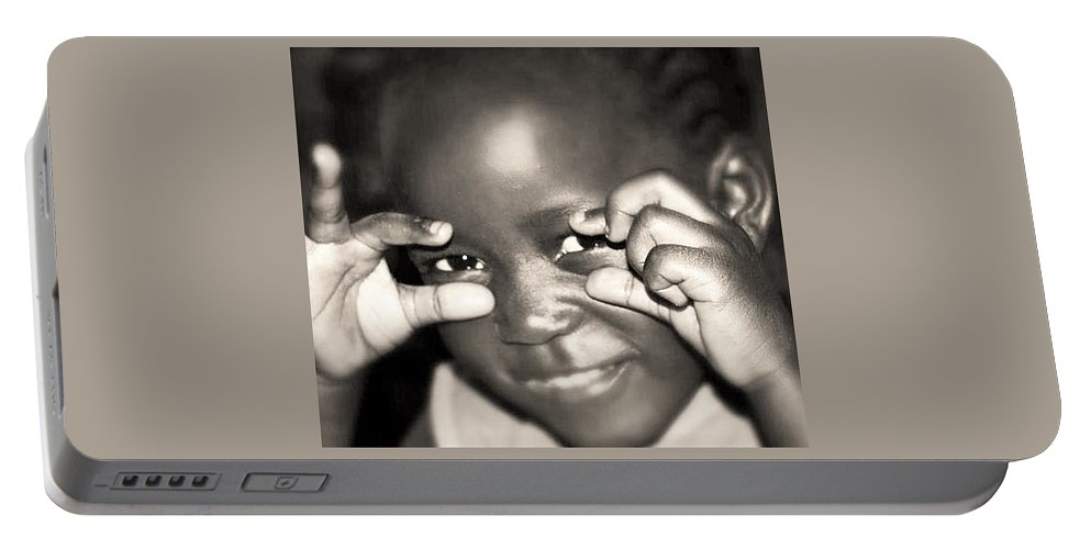Portable Battery Charger featuring the photograph Squishy by Oluwafemi Adeoti