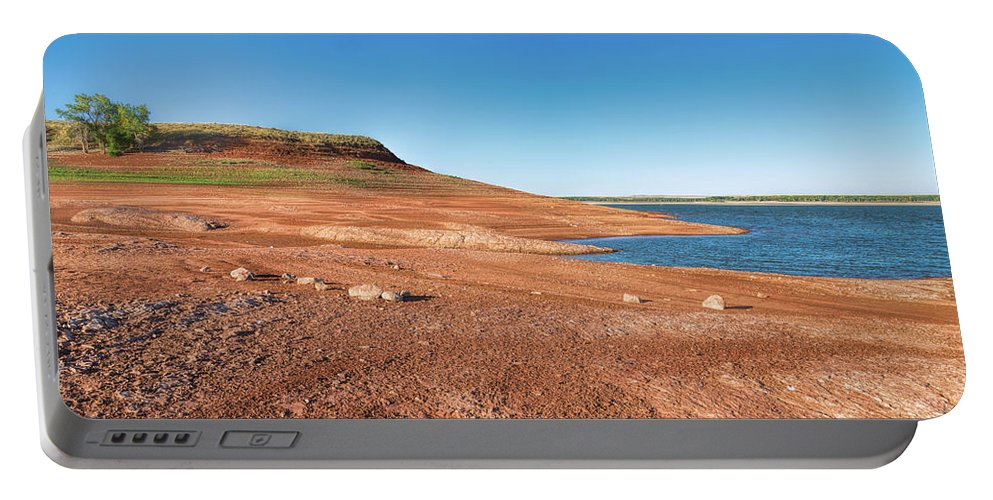 Blue Portable Battery Charger featuring the photograph Standing On The Lakebed by John M Bailey