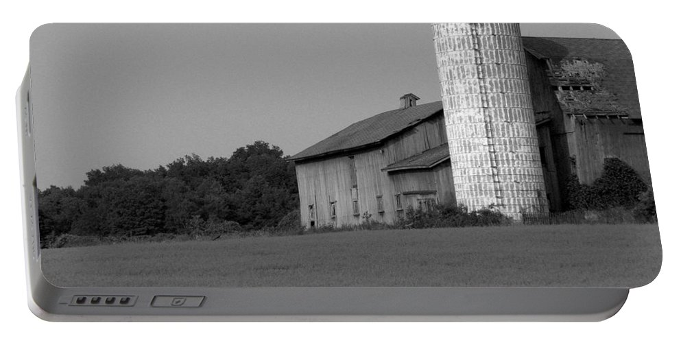 Barn Portable Battery Charger featuring the photograph Still Here by Rhonda Barrett