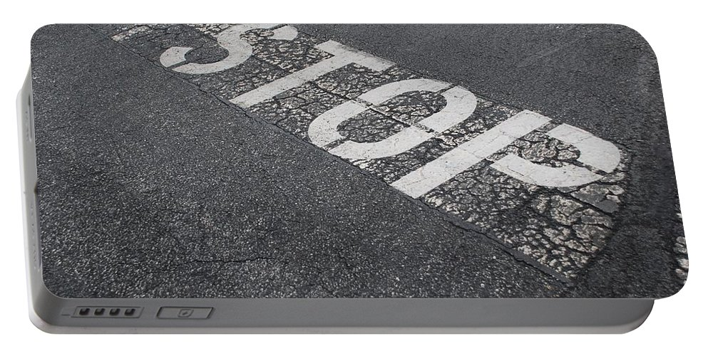 Black And White Portable Battery Charger featuring the photograph Stop Sign by Rob Hans