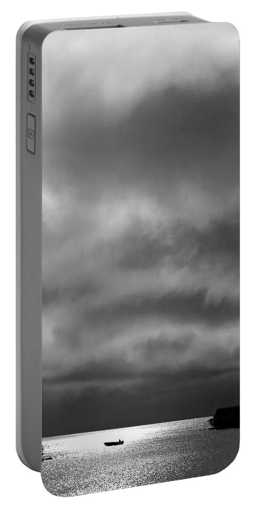 Portable Battery Charger featuring the digital art Storm Clouds Approaching Boat On Northern Saskatchewan Lake by Mark Duffy