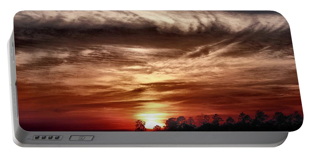 Sunset Portable Battery Charger featuring the photograph Storms Roll by Gina Welch