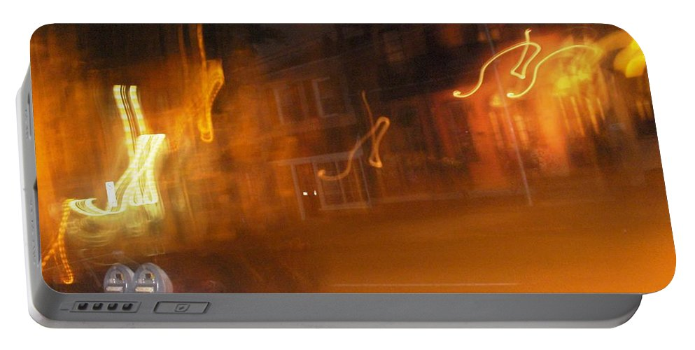 Photograph Portable Battery Charger featuring the photograph Streets On Fire by Thomas Valentine