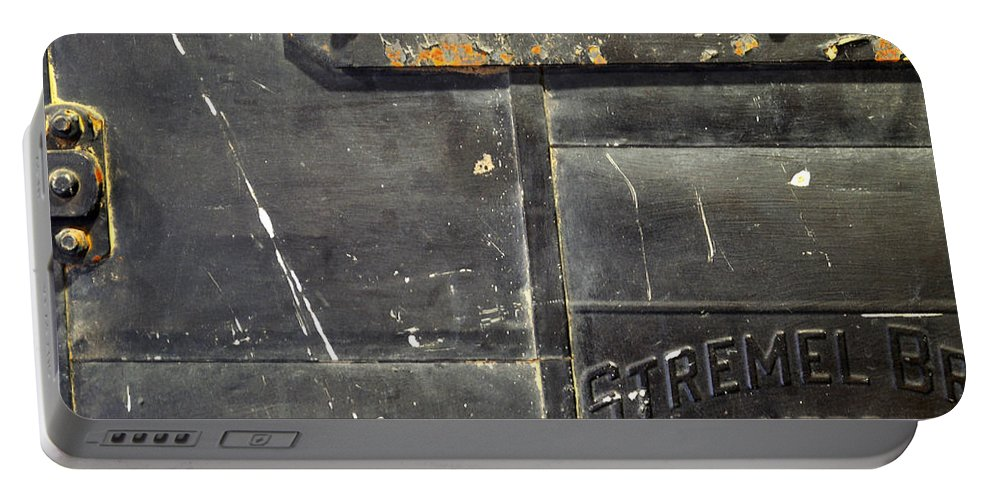 Firedoor Portable Battery Charger featuring the photograph Stremel Bros. Firedoor by Tim Nyberg