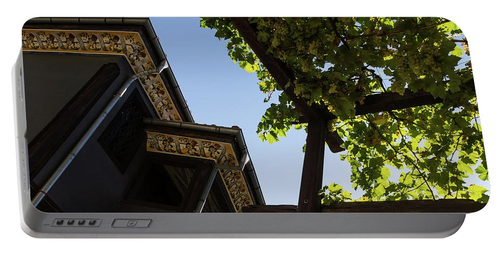 Georgia Mizuleva Portable Battery Charger featuring the photograph Summer Courtyard - Decorated Eaves And Grape Arbors In The Sunshine by Georgia Mizuleva