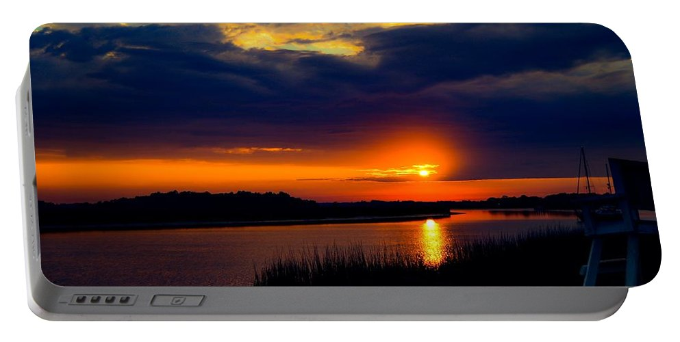 Sunset Portable Battery Charger featuring the photograph Sun Peaking Through by Angela Sherrer