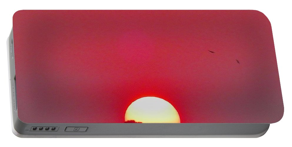 Sun Portable Battery Charger featuring the photograph Sun Setting by Joe Wyman