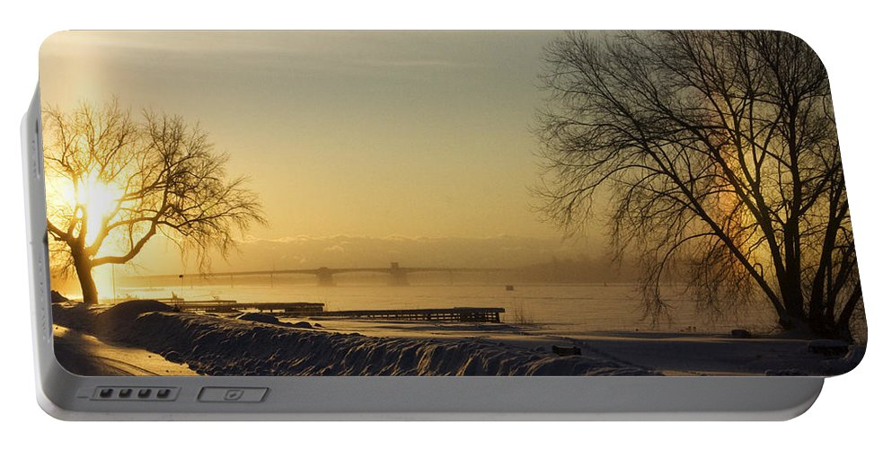 Sun Portable Battery Charger featuring the photograph Sundog On The Bay by Tim Nyberg