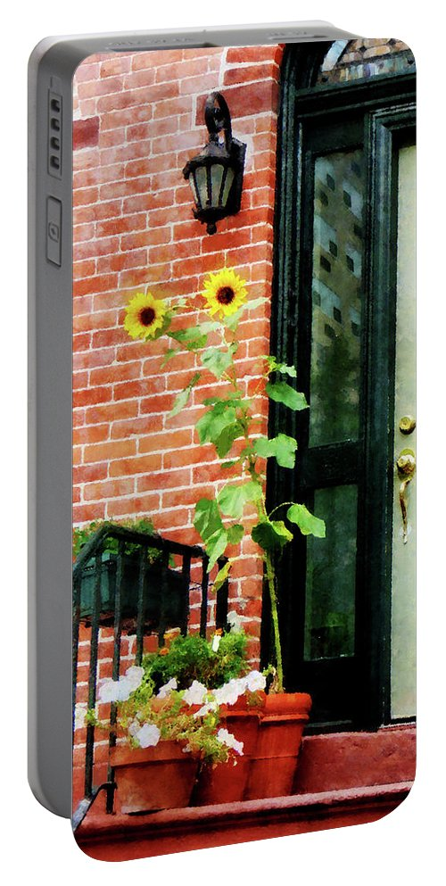 Sunflower Portable Battery Charger featuring the photograph Sunflowers On Stoop by Susan Savad