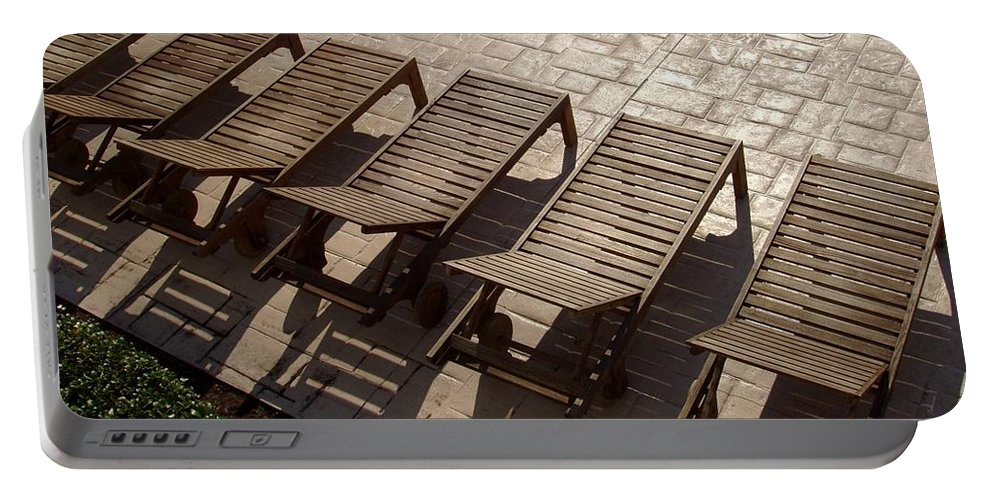 Swimming Pool Portable Battery Charger featuring the photograph Sunning Chairs by Deborah Crew-Johnson