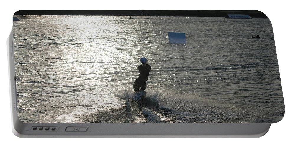 Sun Portable Battery Charger featuring the photograph Sunny Ski by Rob Hans