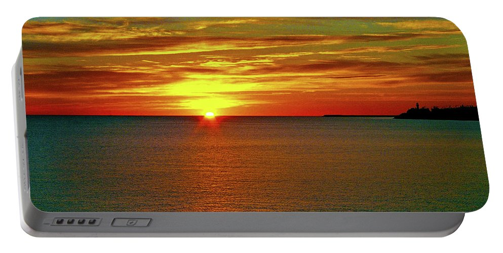 North America Portable Battery Charger featuring the photograph Sunrise At Matane by Juergen Weiss