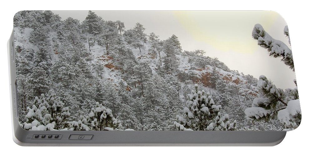 Sun Portable Battery Charger featuring the photograph Sunrise In Snowstorm In The Pike National Forest by Steve Krull