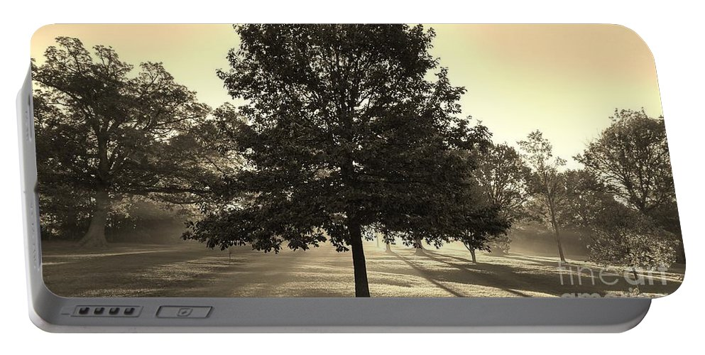 Sunrise Portable Battery Charger featuring the photograph Sunrise In The Mist by Roger Look
