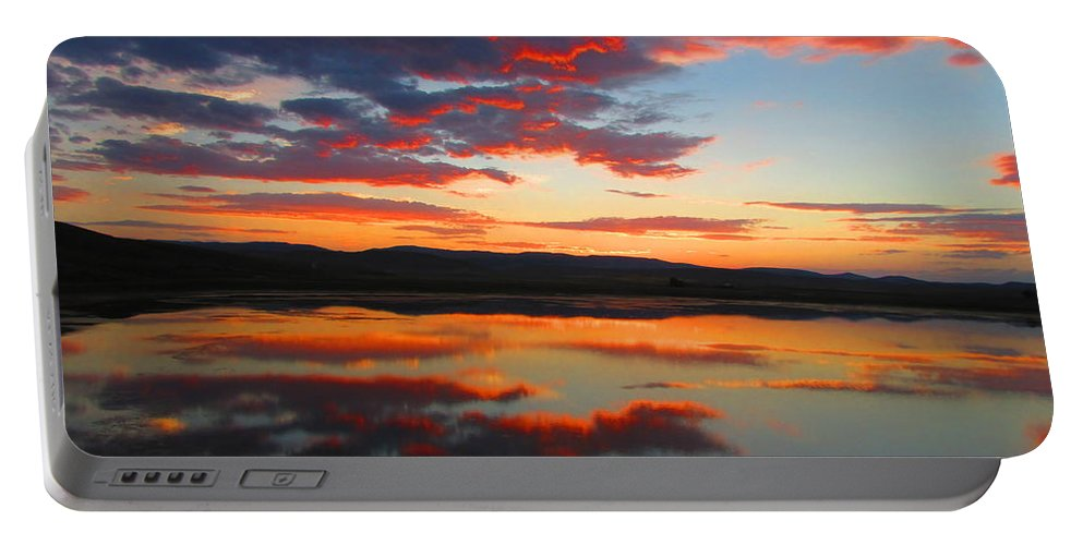 Sunrise Portable Battery Charger featuring the photograph Sunrise Refection by Carol Dyer