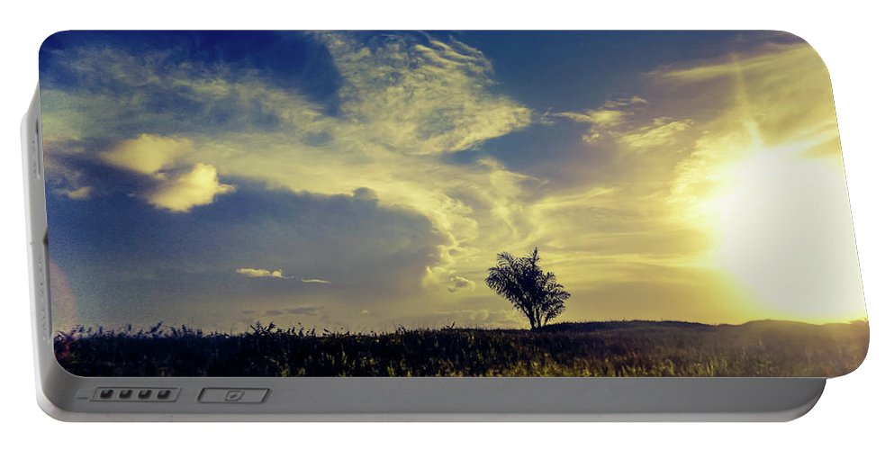 Portable Battery Charger featuring the photograph Sunset At Kuru Kuru by Sawan Jagnarain