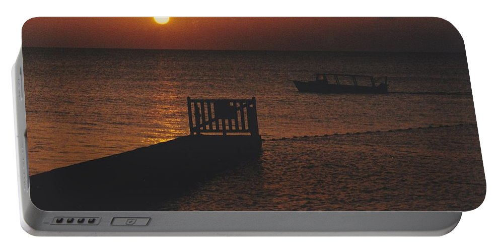 Sunsets Portable Battery Charger featuring the photograph Sunset Boat by Michelle Powell