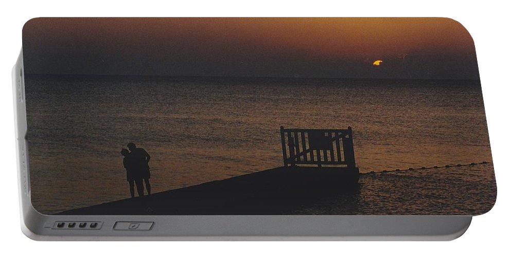 Sunsets Portable Battery Charger featuring the photograph Sunset Couple by Michelle Powell