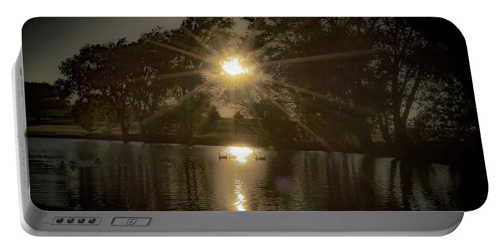 Portable Battery Charger featuring the photograph Sunset Over A Lake by Anthony Lindsay