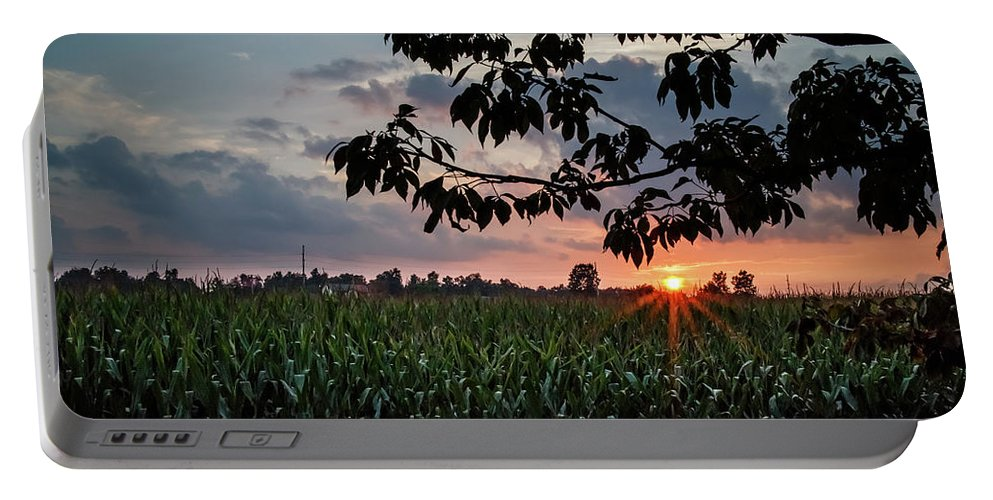 Orange Portable Battery Charger featuring the photograph Sunset Over The Plains by Edward Moorhead