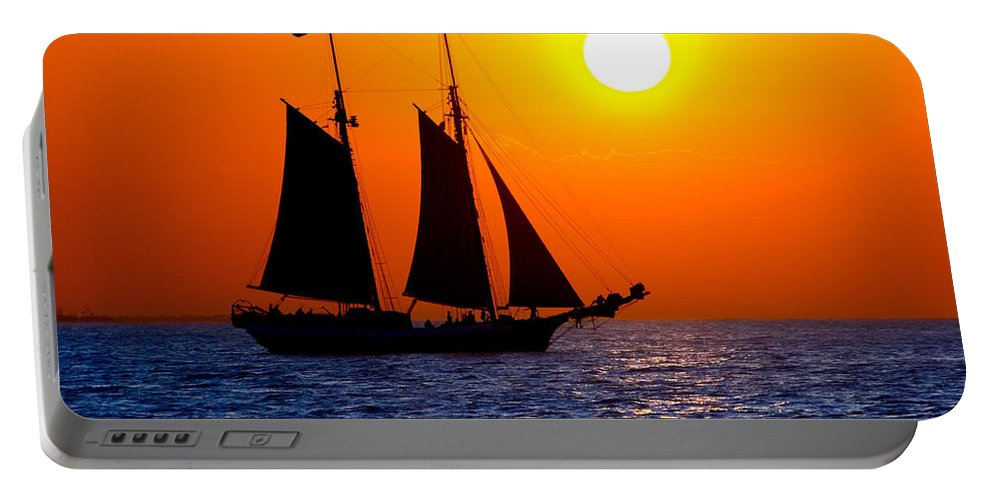 Yellow Portable Battery Charger featuring the photograph Sunset Sailing In Key West Florida by Michael Bessler