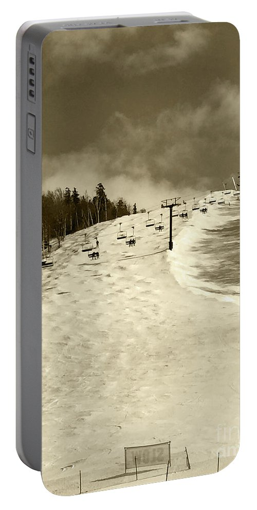 Landscape Photography Portable Battery Charger featuring the photograph Superstar Skiing by Ulli Karner