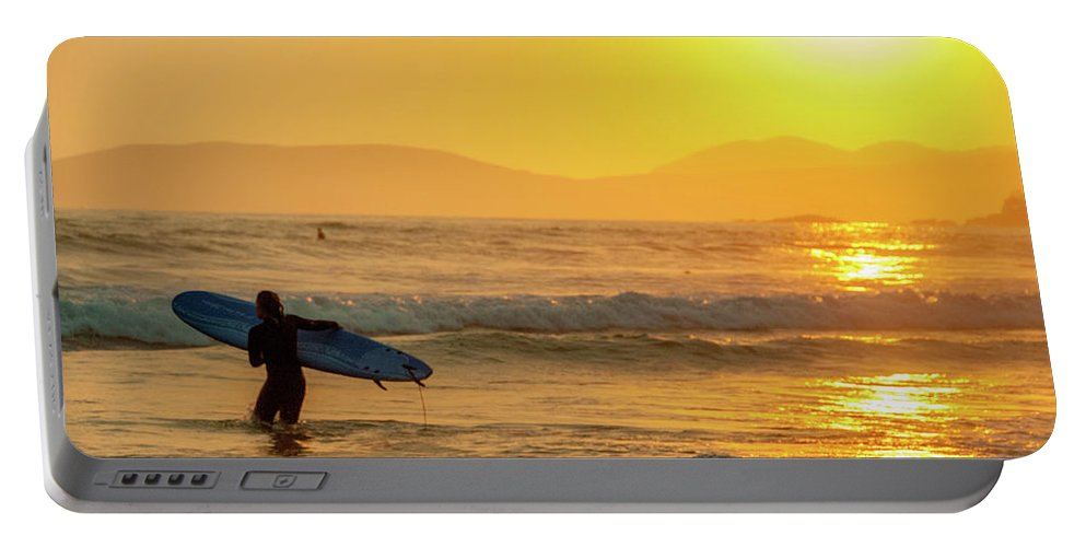 Action Portable Battery Charger featuring the photograph Surfer In The Golden Ocean by Daniel Hernandez