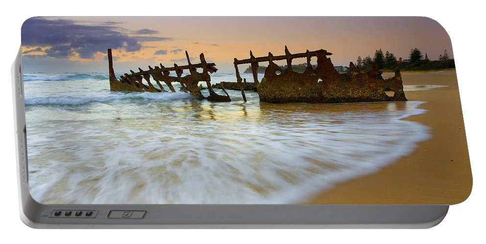 Shipwreck Portable Battery Charger featuring the photograph Swallowed By The Tides by Mike Dawson