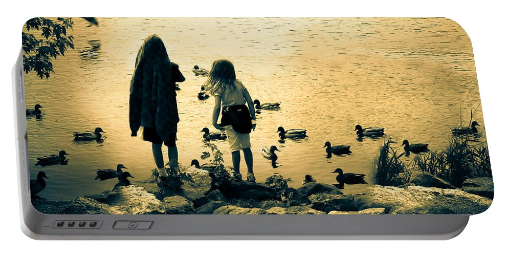Kids Portable Battery Charger featuring the photograph Talking To Ducks by Bob Orsillo