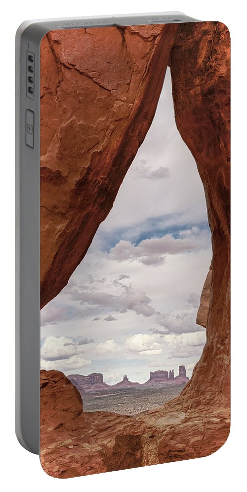 Sky Portable Battery Charger featuring the photograph Teardrop Arch Monument Valley by Craig Voth
