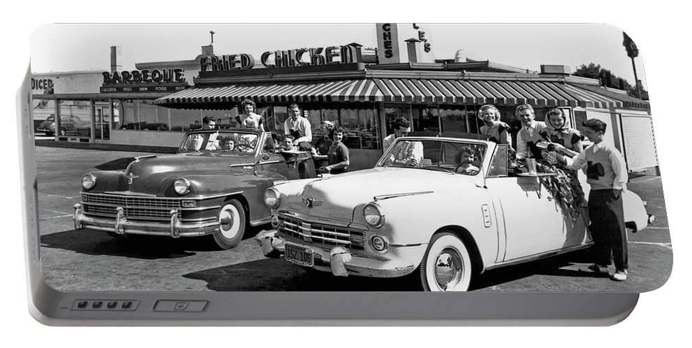 1035-888 Portable Battery Charger featuring the photograph Teens At A Drive In 2 by Underwood Archives