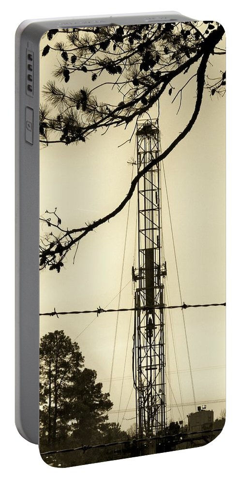 Oil Portable Battery Charger featuring the photograph Texas Tea by Betty Northcutt