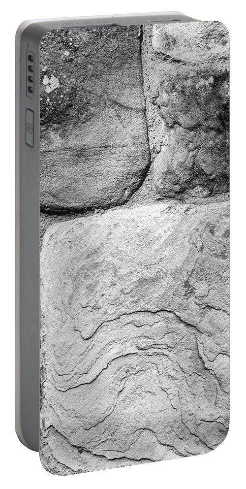 Sand Portable Battery Charger featuring the photograph Textured Stone Wall by Paul Cullen
