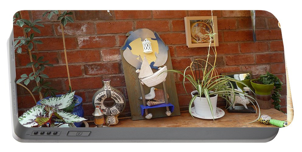 Table Portable Battery Charger featuring the photograph The Artists Bench by Charles Stuart