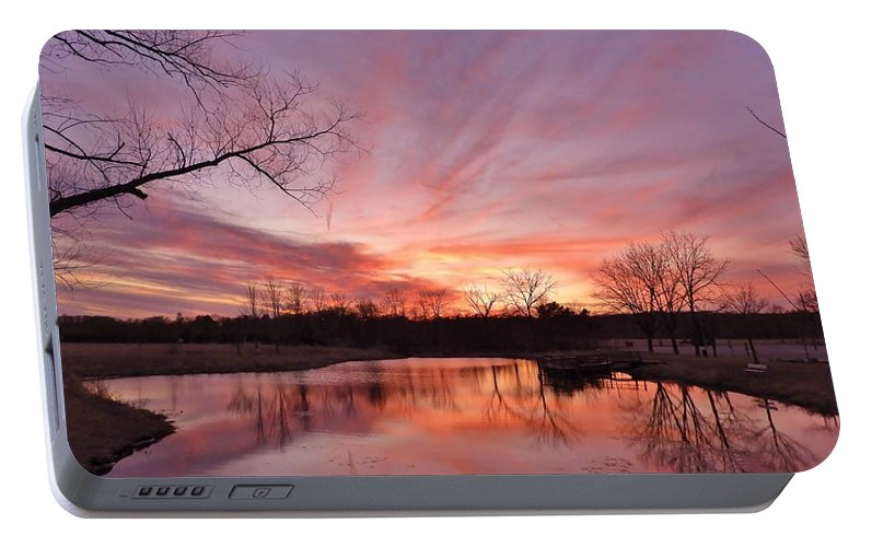 Sunset Portable Battery Charger featuring the photograph The Calm East Of The Storm by Red Cross