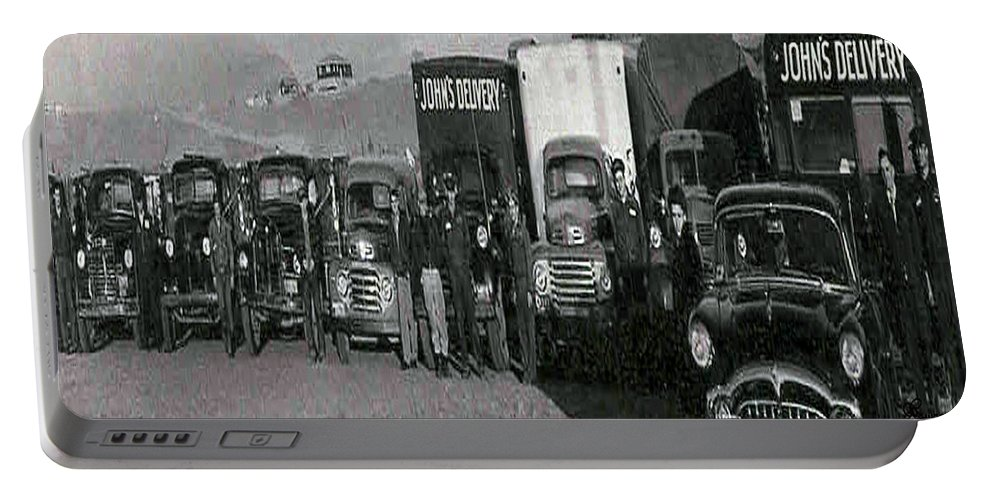 Old Photo Black And White Classic Saskatchewan Pioneers History Old Trucks Portable Battery Charger featuring the photograph The Delivery Company by Andrea Lawrence