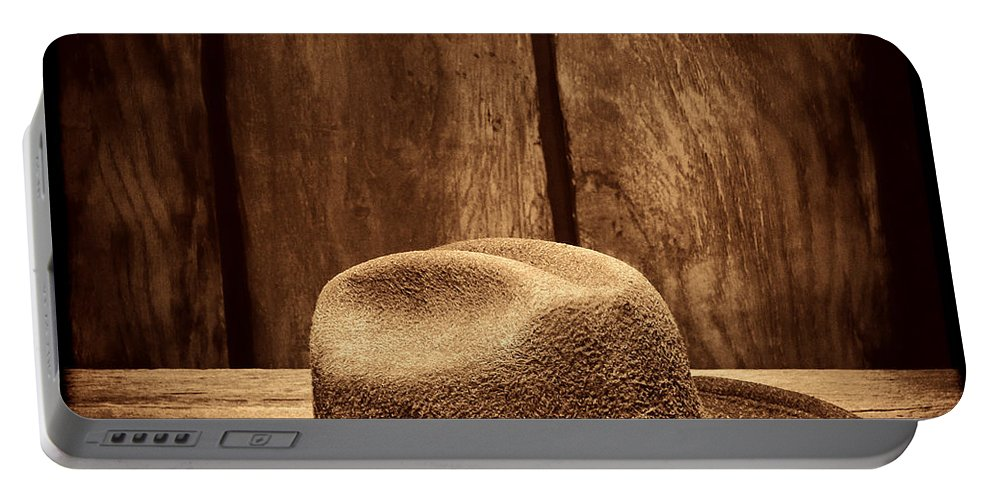 Cowboy Hat Portable Battery Charger featuring the photograph The Dirty Brown Hat by American West Legend By Olivier Le Queinec